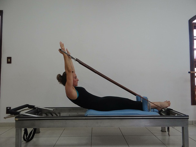 woman stretching on table with resistance bands