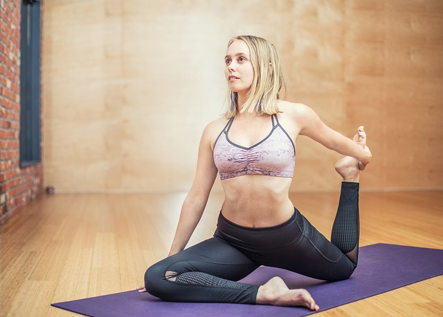 woman performing yoga on mat