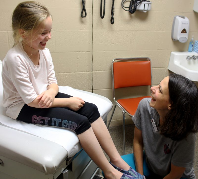 nurse and child talking and laughing